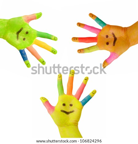 Three colorful hands  with smile painted on palm and happy finger smileys as logo. Concept of partnership, social network or celebration. Isolated on white background with clipping path - stock photo