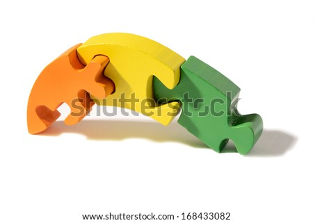 Three colorful interlocked wooden puzzle pieces
