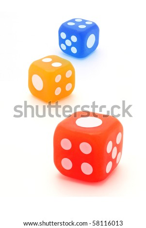 Three colorful rubber dice on white background
