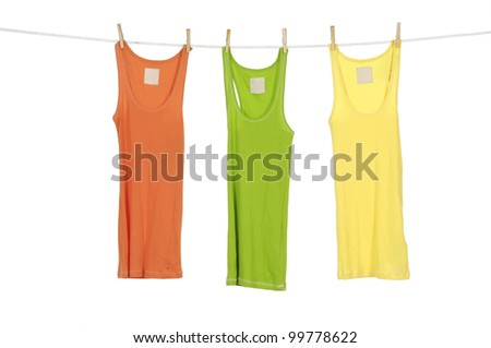 Three colorful shirt clothespins on rope - stock photo