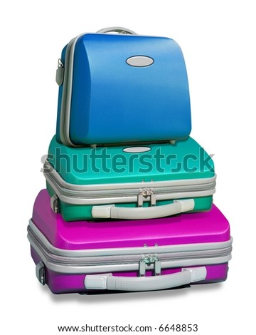 Three colorful suitcases piled on top of each other islolated on a white background with clipping path supplied - stock photo