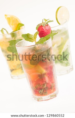 Three colorful variation Mojito cocktails,  Cuban cocktails made from cuban rum, lime, sugar, a splash of soda and flavoured with fresh fruit of your choice - stock photo