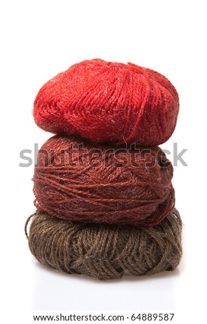 Three colorful wool yarn skeins - stock photo