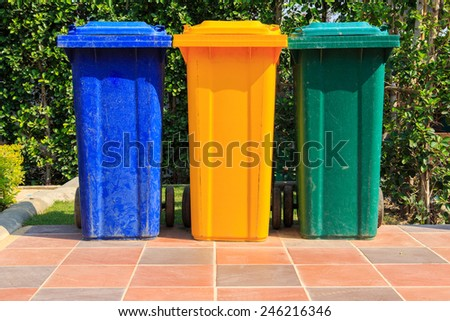 three colors recycle bins at public park - stock photo