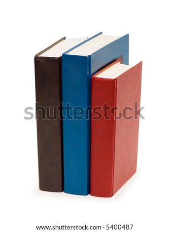 Three colourful books isolated on the white - stock photo