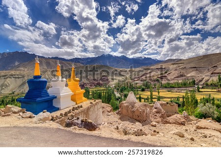 Three colourful buddhist religious stupas at Leh, Ladakh, Jammu and Kashmir, India - stock photo