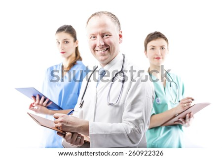 Three competent doctors ready to help isolated on white - stock photo