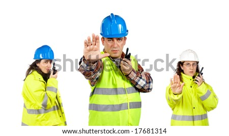 Three construction workers talking with a walkie talkie over a white background. Focus at front - stock photo