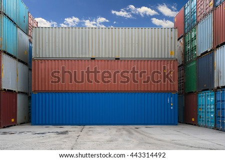 Three containers without labels. Sea container terminal. Storage containers area.