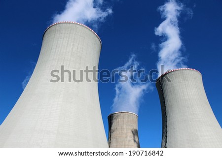 three cooling concrete towers of power plant - stock photo