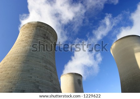 Three cooling towers - stock photo