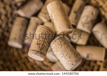 Three corks stoppers um a great cork background - stock photo