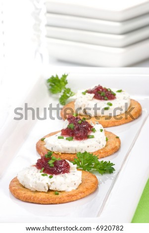 ... goat cheese and cranberry orange sauce on holiday table - stock photo