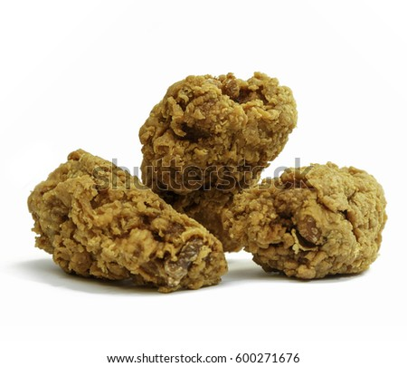 Three Crispy Fried Chicken Drumsticks Isolated on White