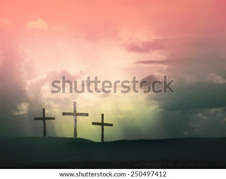 Three crosses against dramatic red sky - stock photo
