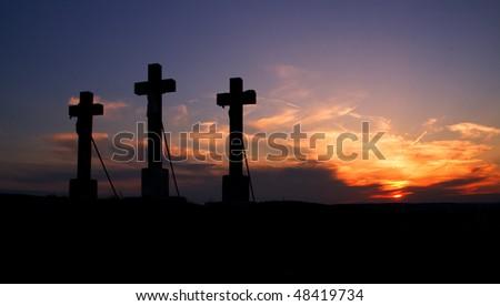 Three crosses on sunset. - stock photo