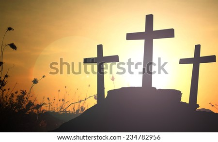 Three crosses over sunset. - stock photo
