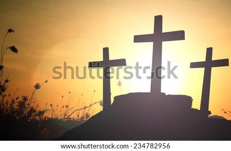 Three crosses over sunset. - stock photo