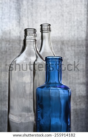 Three crystal bottles against a clear background - stock photo