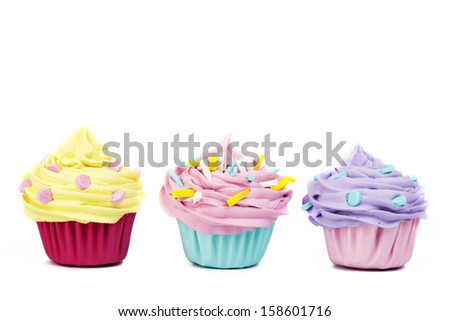 Three cupcakes isolated on a white background - stock photo