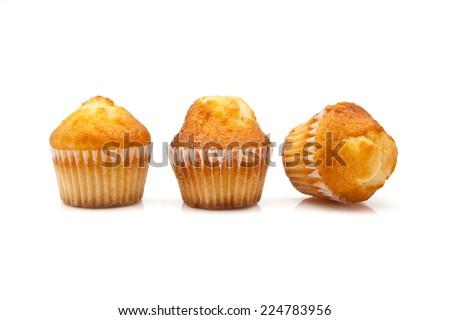 Three cupcakes on white background - stock photo