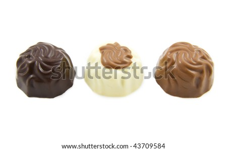 Three cups of chocolate isolated over white