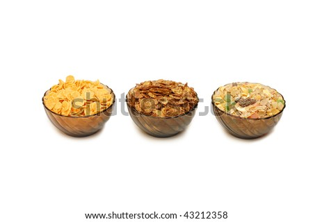 Three cups with different corn flakes