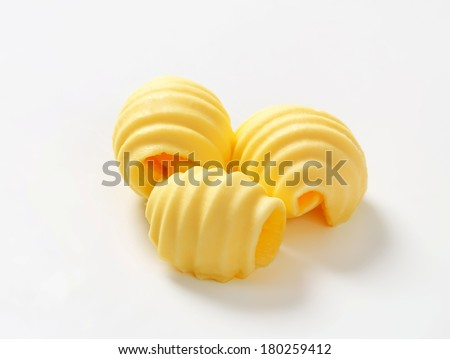 three curls of homemade butter - stock photo