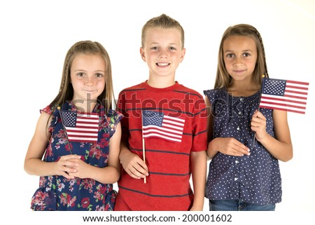 Three cute children holding American flags smiling - stock photo