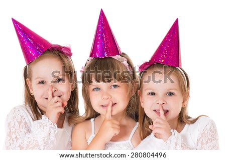 Three cute little girls say silence is a secret  - stock photo