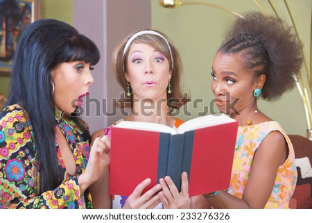 Three cute mature women impressed with a novel - stock photo