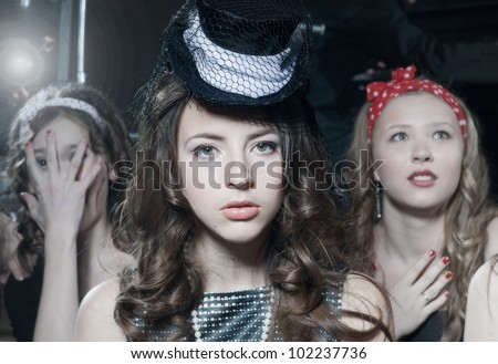 Three cute young girls in retro style - stock photo