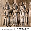 Three dancing apsara on the wall in Angkor Wat, Siem Reap, Cambodia - stock photo