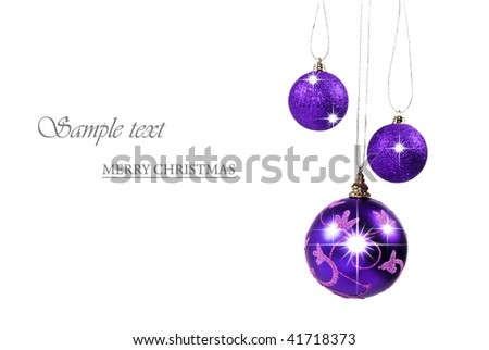 Three dark purple  christmas baubles against white background with space for text - stock photo