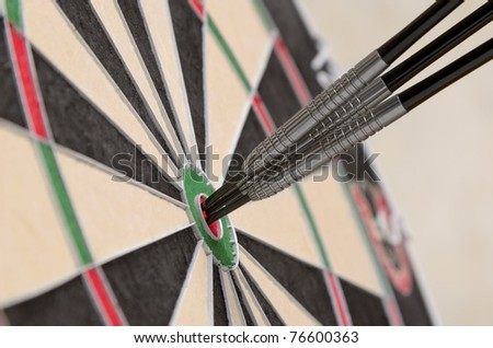 Three darts on target - stock photo