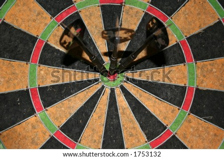 Three darts, side by side in the center