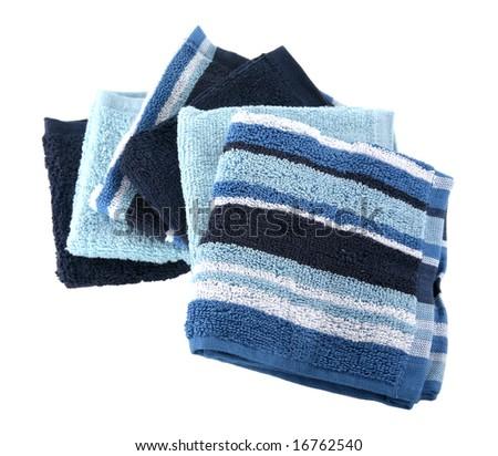Three designs on blue terry cloth washcloths - stock photo