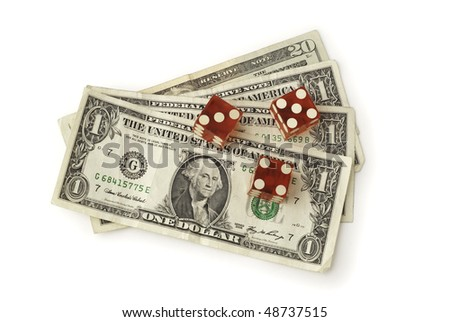 Three dice and some dollar bills shown from straight above on white background. The three dice show the numbers three, four and five. Saved with clipping path