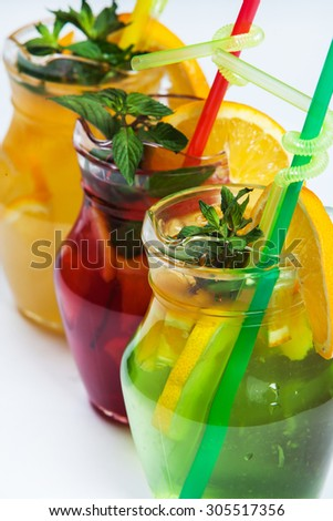 Three different cold drinks Fresh juice mix Three of fruit cocktails. Fruit cold tea cocktails on white background. - stock photo