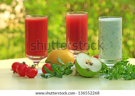 Three different smoothies made of fruits and vegetables