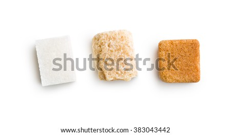 three different sugar cubes on white background - stock photo