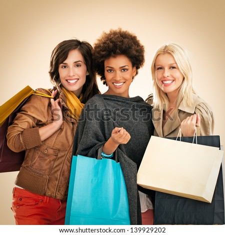 Three different women holding shoping bags. - stock photo