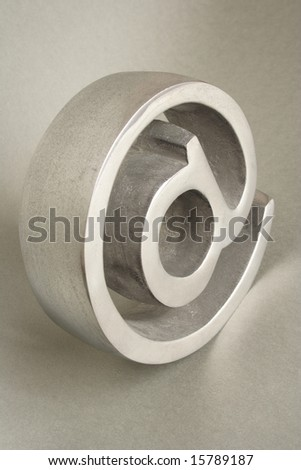 Three dimensional symbol of arroba on gray background - stock photo