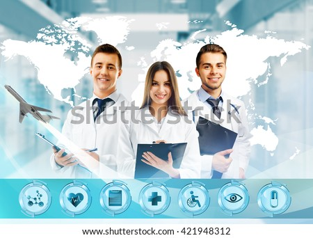 Three doctors and virtual screen. Medical tourism concept - stock photo