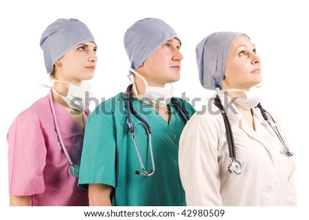 three doctors looking up on white isolated