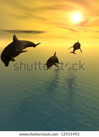 Three dolphins floating at ocean - stock photo