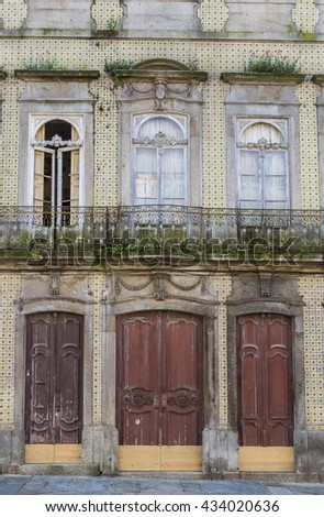 Three door of an old building in Braga, Portugal