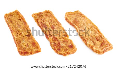 Three dried meat strip snacks, isolated over the white background - stock photo