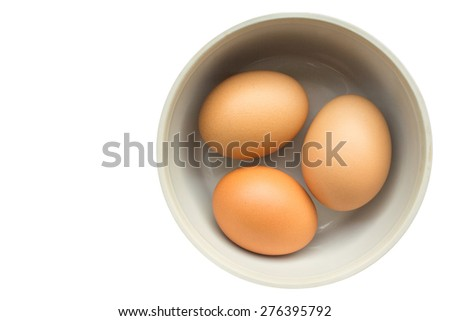 three eggs in a cup Isolated on white background - stock photo