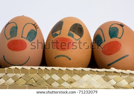 three eggs with different expressions